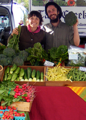 Amber and Jonah at market stand in 2010