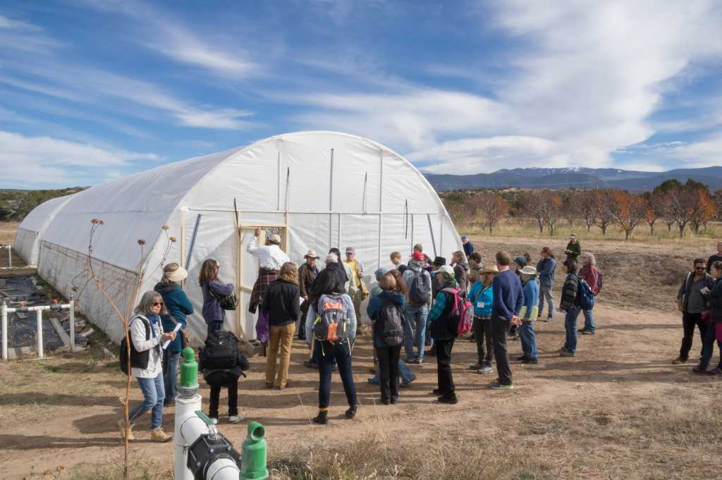 Touring the greenhouse at Tesuque Pueblo