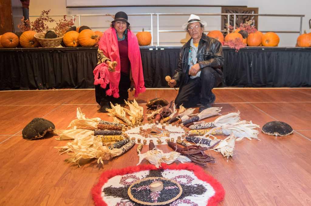 Danza Azteca prepares a seed mandala