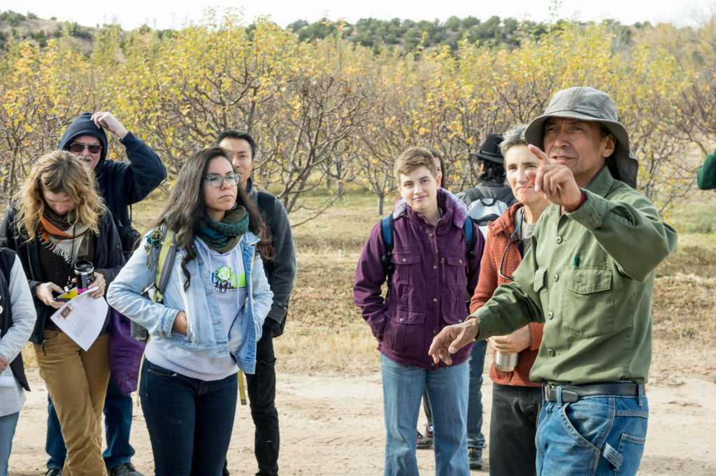 Emigdio Ballon during a pre-conference field day to Tesuque Pueblo, where members of the Pueblo have developed farm fields, orchards, greenhouses, compost, and a seed bank